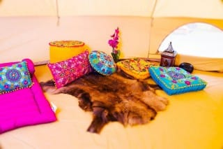 Suzani Cushions and Skeep Skin Rug