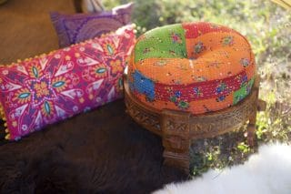 Wooden Stool With Multicoloured Cushion and Suzani Cushions
