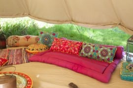 Suzani Cushions and Fuchsia Roll Up Bed
