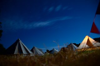 Sandstone Bell Tents at Night