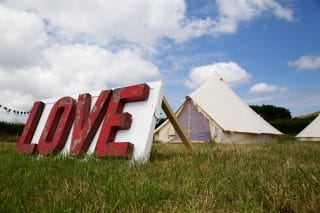 'Love' Sign and Sandstone Tent