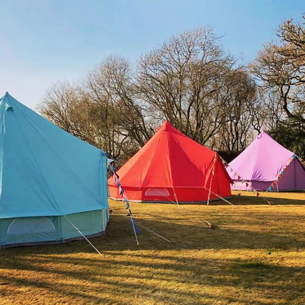 Sky Blue, Coral Red and Pastel Lilac Bell Tent in the sunshine!