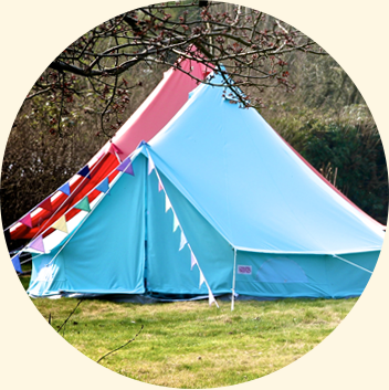 Blue Bell Tent in front of red
